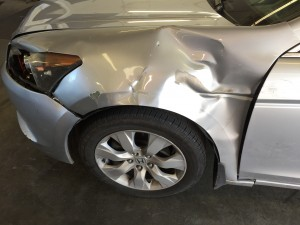 sedan-drivers-side-fender-collision-damage